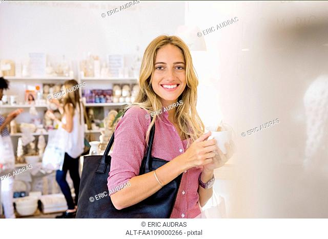 Young woman shopping, portrait