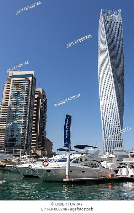 YACHTS MOORED AT THE FOOT OF THE CAYAN TOWER, ALSO KNOWN AS THE INFINITY TOWER, DUBAI MARINA, DUBAI, UNITED ARAB EMIRATES, MIDDLE EAST
