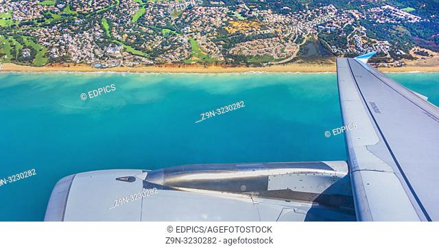algarve coast seen from aircraft window approaching faro airport, faro, algarve, portugal