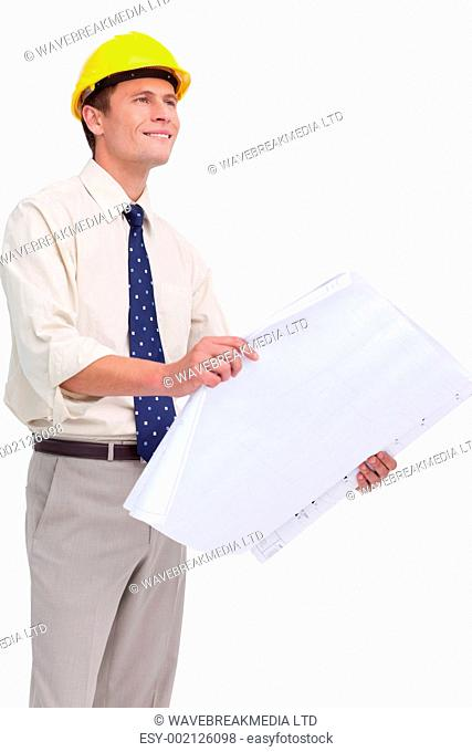 Architect with plans in his hands against a white background