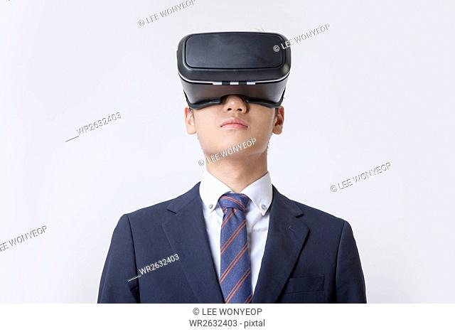 Portrait of young businessman wearing virtual reality headset