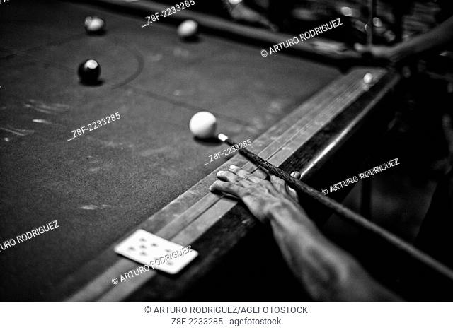 A group of men play pool in a slum in Yangon, Myanmar, Tuesday, May 7, 2013. (Photo/Arturo Rodriguez)