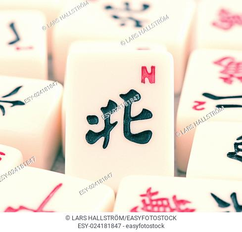Mahjong board game pieces in close up. Concept of asian or chinese leisure activity, recreation and traditional games