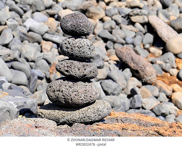 stacked lava stones in balance