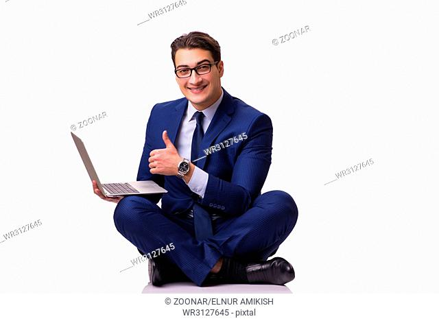 The businessman sitting on the floor isolated on white