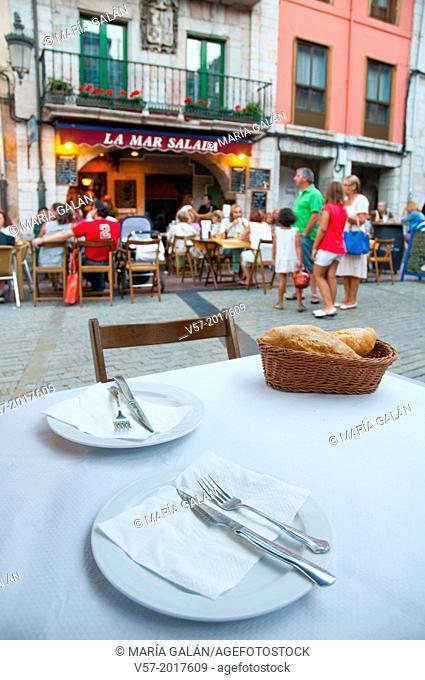Set table in the street. Ribadesella, Asturias, Spain