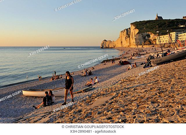 people enjoying sunset on the beach of Etretat, Seine-Maritime department, Normandie region, France, Europe