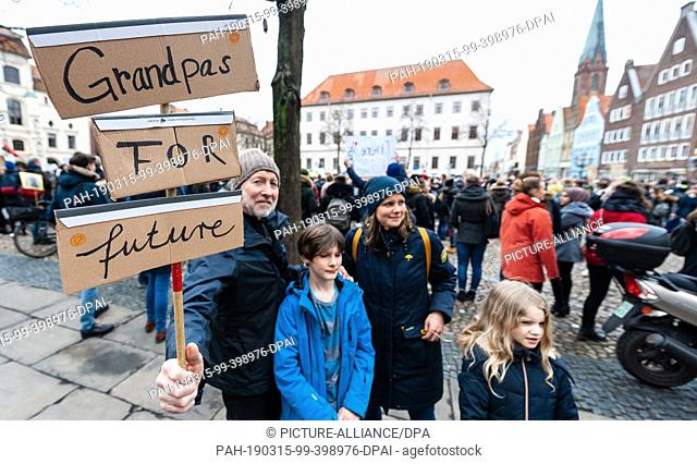 "15 March 2019, Lower Saxony, Lüneburg: Grandpa Albert (l) takes part in the """"Fridays for Future"""" movement for a different climate policy with his..."
