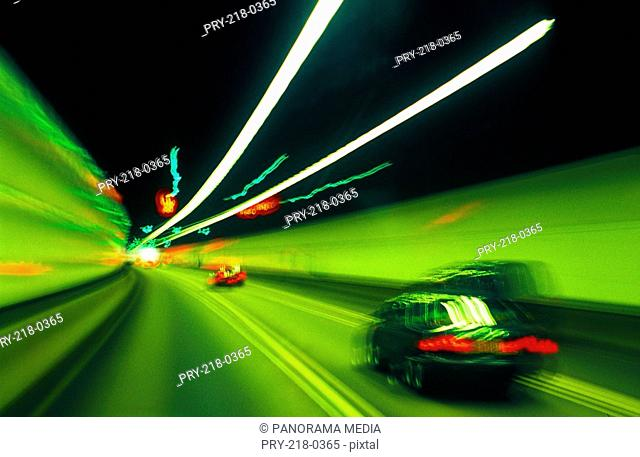 Creative shot of running cars and light
