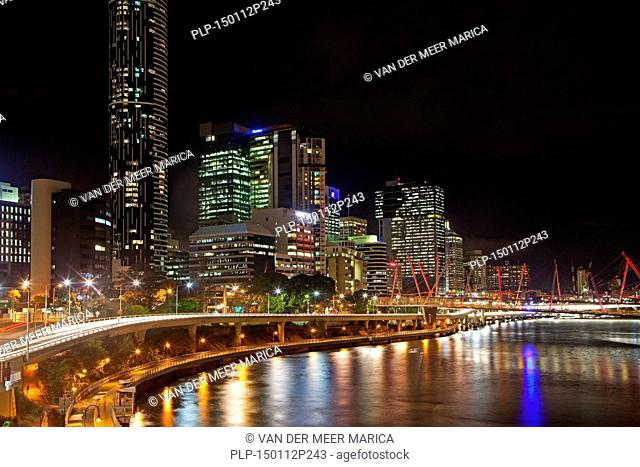 Skyline of Brisbane central business district / CBD showing skyscrapers, flats and highrise office blocks by night, capital city of Queensland, Australia