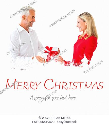 Composite image of smiling couple holding a gift