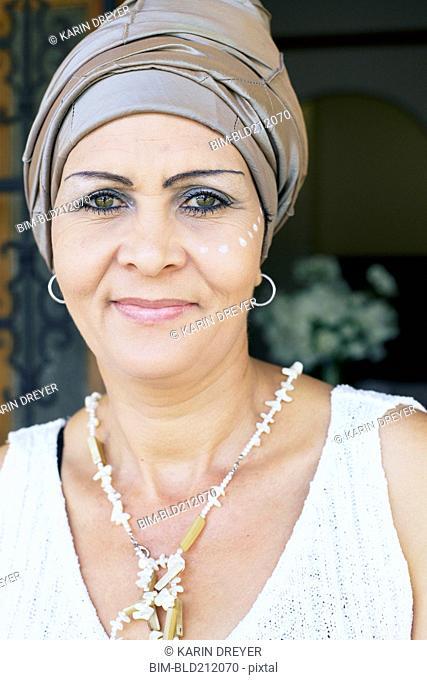 Mixed race woman wearing turban