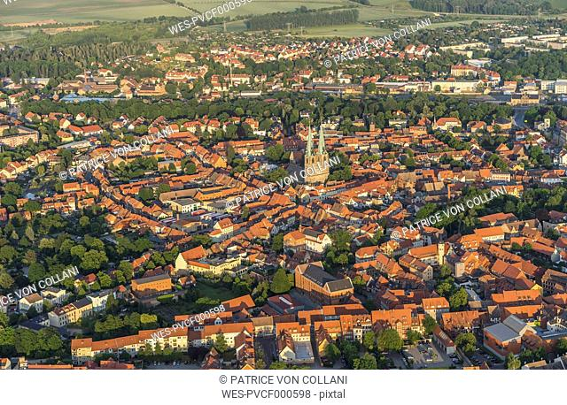 Germany, aerial view of Quedlinburg with St Nicholas' Church at evening twilight