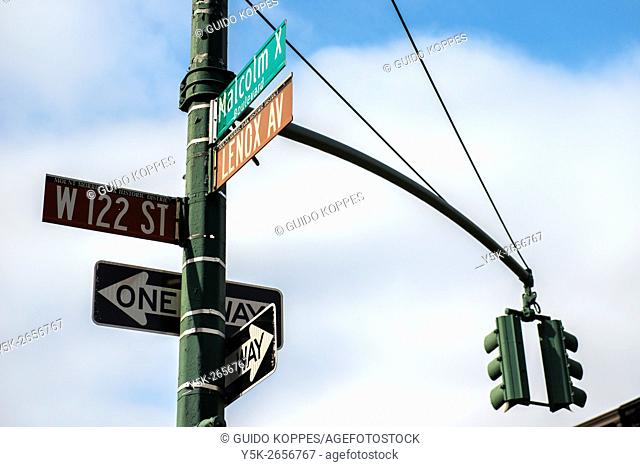 New York City, USA. Streetsign with traffic lights at Lenox Av, Malcolm X Bloulevard and 122nd Street, Harlem, Manhattan