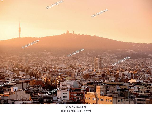 Elevated hazy cityscape with distant view of montjuic, Barcelona, Spain