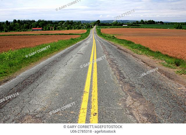 an old paved road in the Annapolis Valley in Nova Scotia Canada