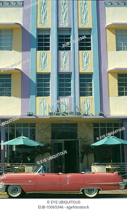 Ocean Drive. Pink Cadillac parked outside Art Deco style Marlin Hotel on South Beach