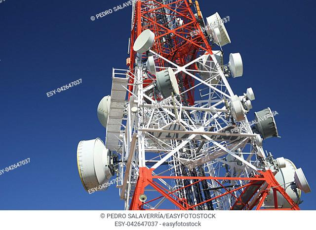 Telecommunications tower with clear blue sky