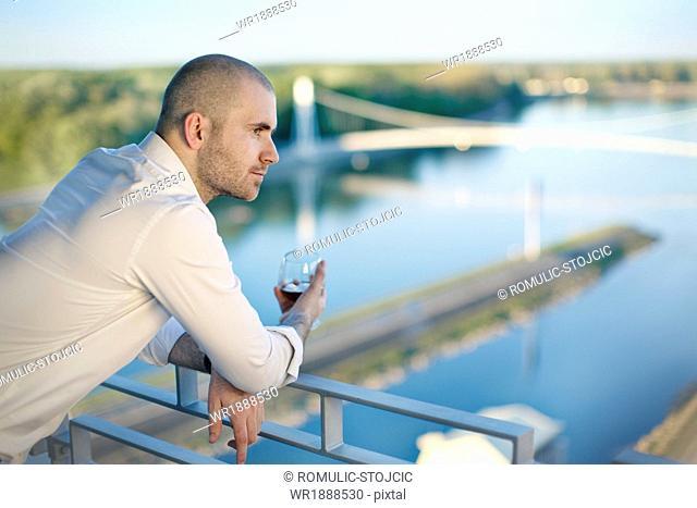 Young Man Leaning On Banister, Osijek, Croatia
