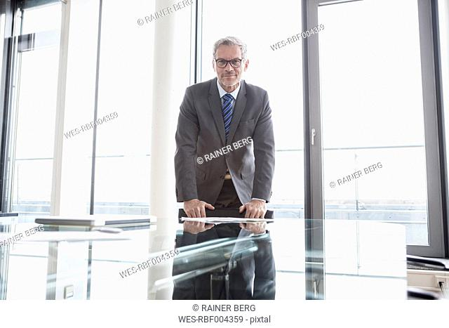 Successful manager standing in conference room