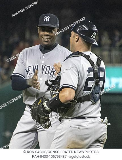 New York Yankees relief pitcher Aroldis Chapman (54) and catcher Austin Romine (28) celebrate their team's victory over the Washington Nationals at Nationals...