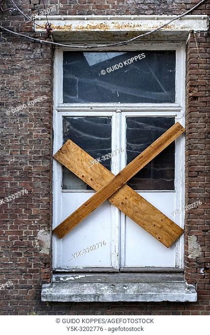 Antwerp, Beligium. Godshuis Lantschot. Historical or Retro designed door and entrance inside a building's facade