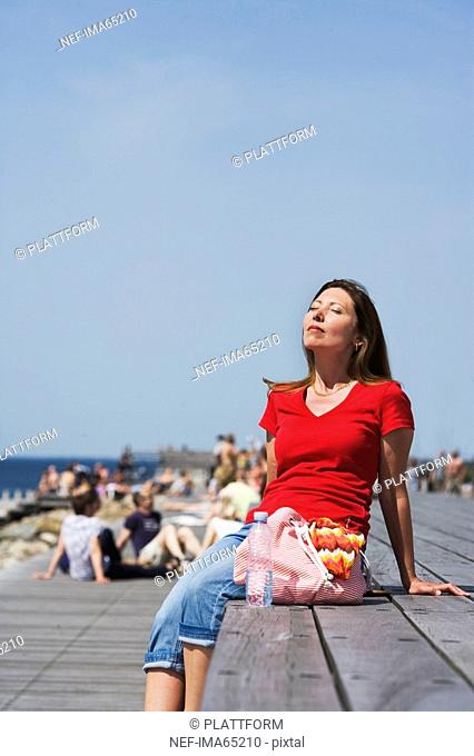 A woman enjoying the sun Skane Sweden