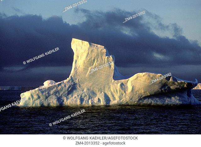 ANTARCTICA, ICEBERG IN EVENING LIGHT