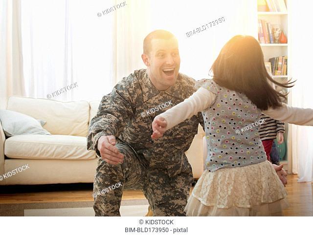Caucasian soldier greeting daughter