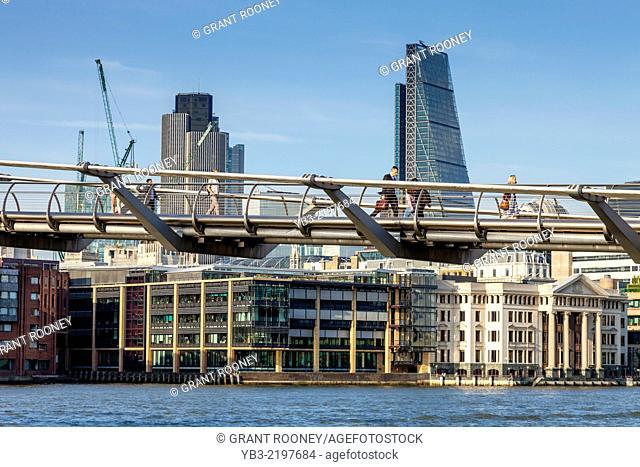 People Crossing The Millennium Bridge, London, England
