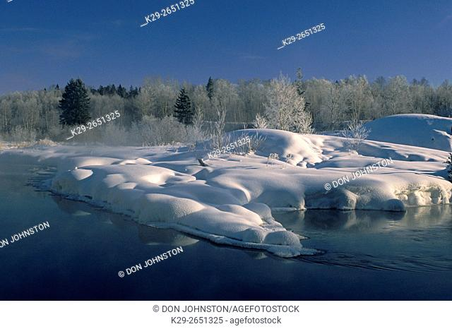 Open water with frost and snow in Junction Creek, Greater Sudbury, Ontario, Canada