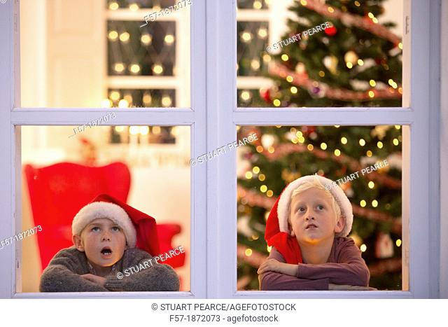 Two eight year old friends waiting for Santa Claus