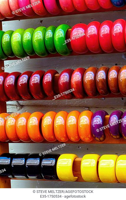 colored bracelets stacked on poles