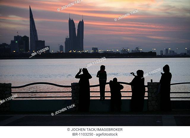 Skyline of the Corniche as seen from King Faisal Highway, Muharraq side, World Trade Center buildings, left, beside the towers of the Financial Harbour Complex