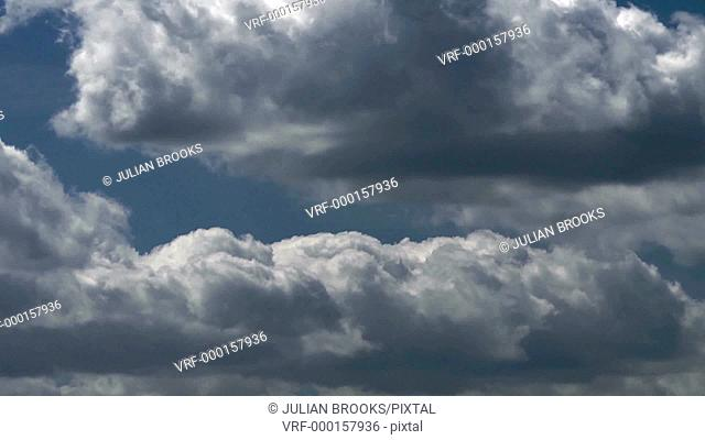 close up of growing cloud formation time lapse against blue sky