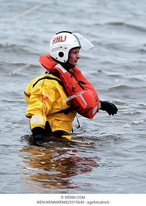 Hundreds of Loony Dookers take part in the traditional New Year's Day dip in the River Forth. Featuring: RNLI, Atmosphere Where: South Queensferry