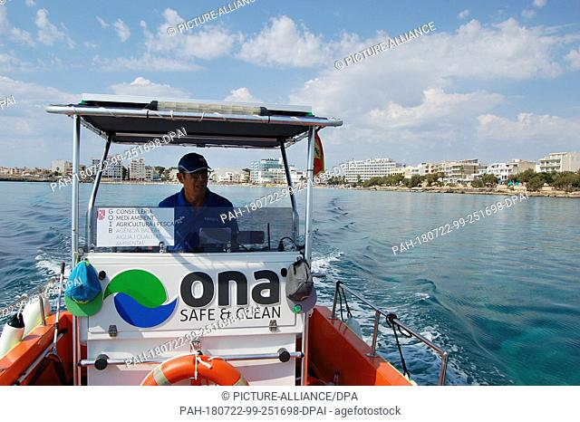 10 July 2018, Spain, Mallorca, S·Illot:Joan Adrover patrols the coast with his cutter. More than a dozen boats are on duty at the coast every day