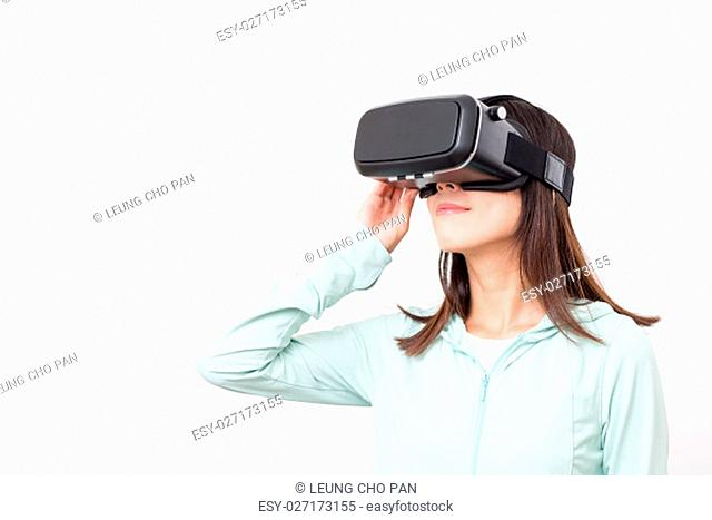Asian woman experience though VR glasses