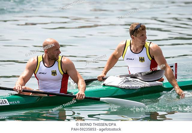 Germany's Ronald Rauhe (L) and Tom Liebscher paddle back to the shore after finishing second place in the Men's Kayak Double K2 200m final at the 2015 European...