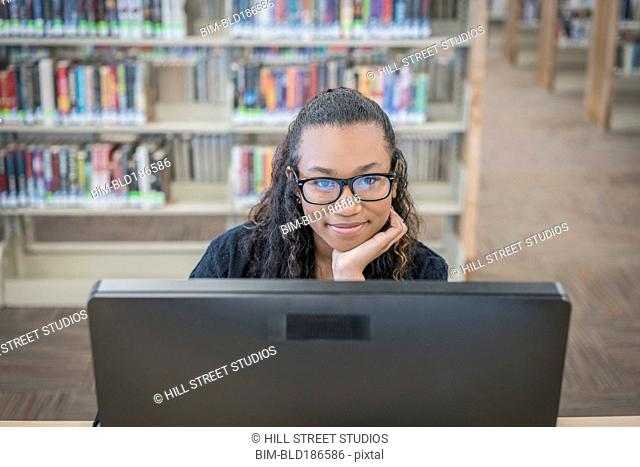 Student using computer in library