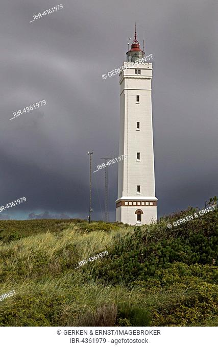 Lighthouse against stormy sky, Blavandshuk near Blavand, Jutland, Denmark