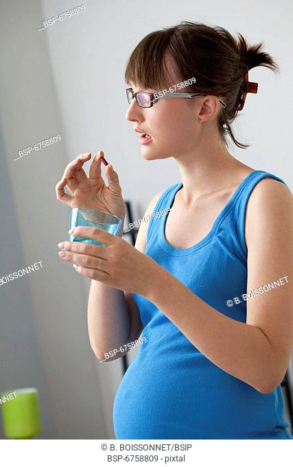 PREGNANT WOMAN TAKING MEDICATION Model