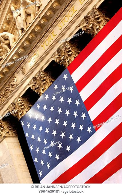 Giant American Flag across the front of the New York Stock Exchange Building in Lower Manhattan, New York City, USA