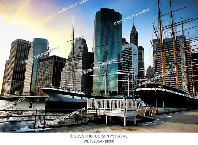 South Street Seaport at sunset. The South Street Seaport is a historic area in the New York City borough of Manhattan, located where Fulton Street meets the...