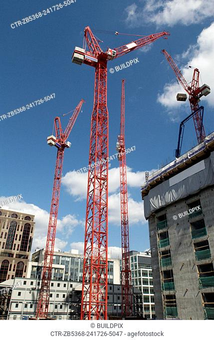 Cranes on a new office development in the city, London, UK