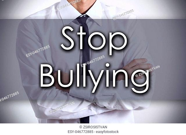 Stop Bullying - Closeup of a young businessman with text - business concept - horizontal image