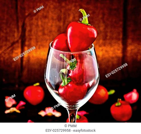 Red hot chili peppers, a symbol of passion, in glass