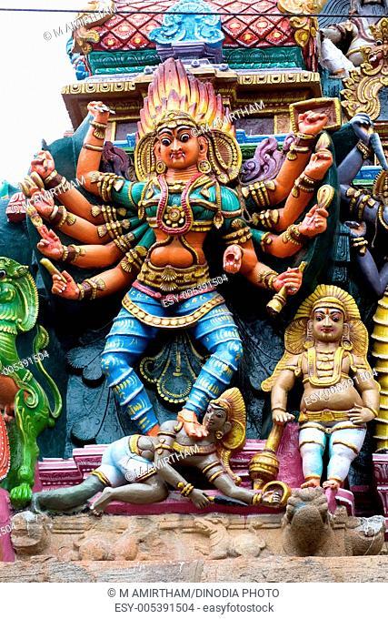 Goddess bhadrakali stucco figure on gopuram of sri meenakshi temple ; Madurai; Tamil Nadu ; India August-2009