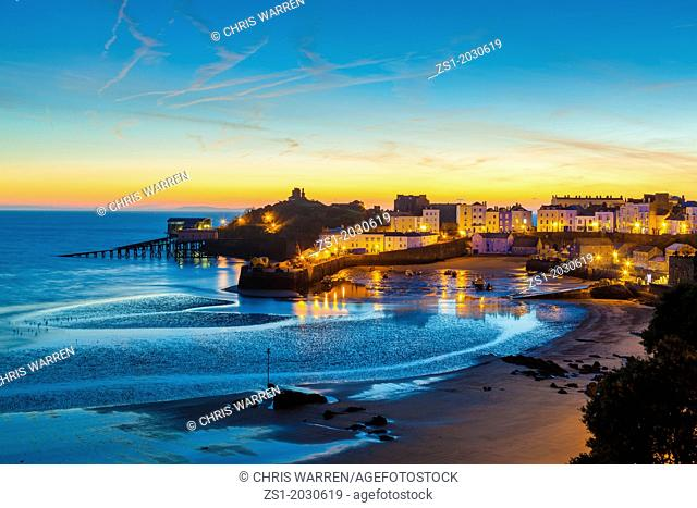 Dawn breaking over Tenby Harbour Tenby Pembrokeshire Wales.1015