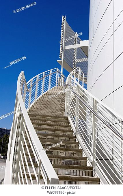 Exterior white stairs and railing curve around the white rotunda of the San Jose City Hall building in San Jose, California  Shows compelling lines and curves...